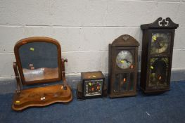 A VICTORIAN FLAME MAHOGANY SWINGING DRESSING MIRROR, along with two wall clocks and an Art Deco