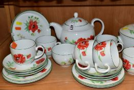 A ROYAL WORCESTER 'POPPIES' PATTERN PART DINNER SERVICE, comprising tea pot and cover, three tureens