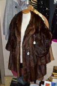 A MUSQUASH FUR COAT, approximate size 14/16, a squirrel fur stole (National Fur Company), a Kesta