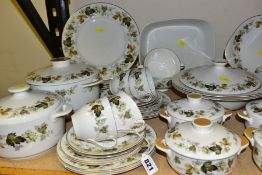 A ROYAL DOULTON LARCHMENT PATTERN (TC1019) DINNER SERVICE, comprising three various twin handled