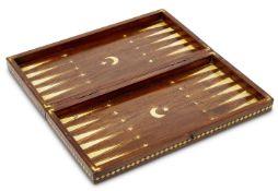 An ivory inlaid mahogany backgammon board, Turkey, early 20th century, the interior with crescent