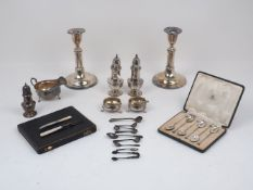 A collection of silver and silver plate items, to include a pair of George IV salt and pepper dishes