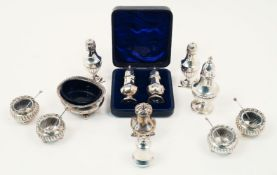 A selection of silver cruets comprising: a George III silver cruet dish with gadroon edge, London,