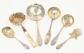 A group of six French silver straining spoons and servers, various designs and makers including a
