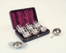 A cased set of late Victorian silver cup holders with glass inserts, London, c.1890, William Comyns,