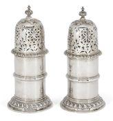 A pair of cylindrical Britannia silver sugar casters, London, c.1914, Solomon Joel Phillips, each