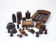 A collection of carved treen items, 19th century and later, to include a turned wood seal stamped '