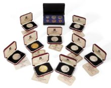 A collection of nine commemorative proof crowns, comprising: crowns - two silver gilt, the Queen's