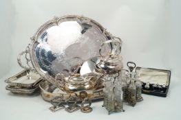 A quantity of silver plate comprising: two large silver plated trays, 60.5 and 76cm long; a cased