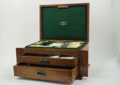 An oak cased part-canteen of silver plated flatware retailed by Joseph Rodgers & Sons., the oak case
