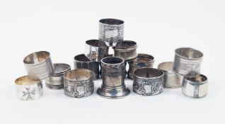A group of seven various French silver napkin rings, together with a Norwegian silver example,