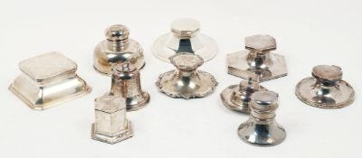 Ten silver inkwells including: an example by Mappin and Webb, Birmingham, c.1931, of spreading