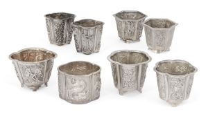 Eight various Chinese white metal salts, all stamped TYT, of various shapes and designs including