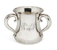 An American silver three-handled cup (tyg), of waisted form with scroll handles and monograms to
