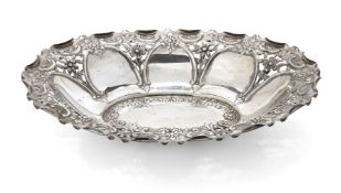 An Edwardian pierced silver repousse dish, Chester, c.1910, James Deakin & Sons, of shaped oval
