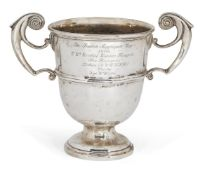 A twin-handled silver trophy cup, London, c.1904, Skinner & Co., designed with bifurcated stylised