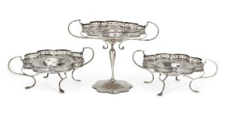 A set of three silver compotes, Birmingham, c.1921, G&C&Co, each designed with bifurcated twin