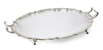 A twin-handled George V silver tray, Birmingham, c.1927, Barker Brothers, of shaped oval form with