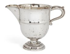 An Edwardian silver jug, London, c.1909, Charles Boyton & Son Ltd, of rounded form, with acanthus