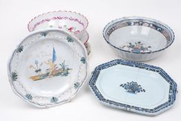 A collection of continental tin-glazed earthenware platters and bowls, late 19th century and