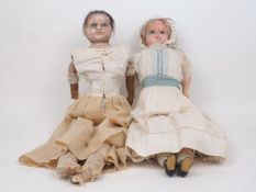 A Victorian wax over composition doll, circa. 1850 -60, in original under garments, with leather