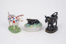 A group of Staffordshire creamers and butter dish, mid-19th century and later, to include a