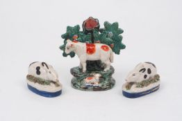 A Staffordshire sheep form spill vase, circa. 1820-30, modelled standing, atop a naturalistic