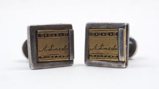 A pair of A. Lincoln cufflinks, the white metal links with yellow metal sliding panel signed 'A.