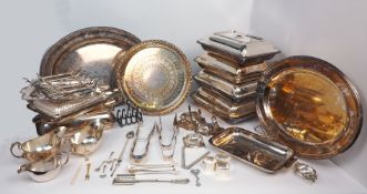 A quantity of silver plate including: a large oval tray with gadroon border; several tureen