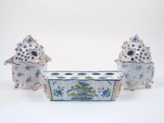 A Delft style ceramic bulb box, late 18th / early 19th century, decorated to the exterior with