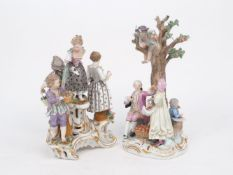 A Meissen figure group depicting apple pickers, late 19th Century, featuring a seated gentleman with