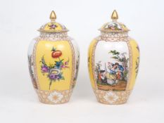 A pair of Dresden Augustus Rex vases and covers, 19th Century, painted with panels of scenes after