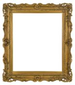 A Gilded Composition Louis XV Style Frame, late 19th-early 20th century, with wedge sight, stiff