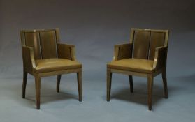 A pair of stained wood armchairs by Phillip Hurel, late 20th Century, each with slatted backs and