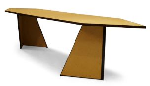 Andrew Kindler, a modern chipboard dining table, of recent manufacture, the shaped top on two