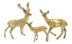 A group of three brass deer, British, circa. 1960, each of plain polished form, tallest 18cm high (