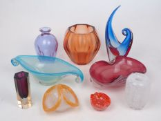 A group of modern multi-coloured glass comprising: a Moser dichroic blue/mauve glass bottle (no