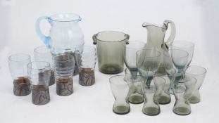A grey glass lemonade set, comprising: a plain polished jug, 19cm high and matching ice bucket, with