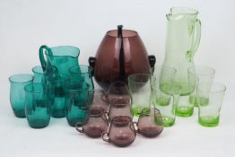 A group of modern glass hosting sets, comprising: a purple glass punch bowl, of globular form,