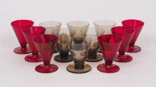 A set of six grey glass firing glasses, 20th century, of typical form, with conical bowls and flat