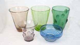 A green glass vase with inherent vertical banding, on a circular spreading foot, 26 cm high;