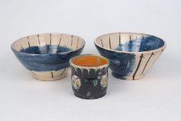 David Garland (1941-), c.1990, signed to base, two cream glazed bowls with blue and brown