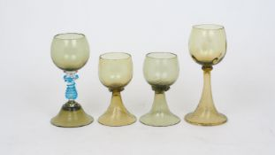 Four German green glass hock glasses, late 19th/early 20th century, to include: a pair, 12cm high, a