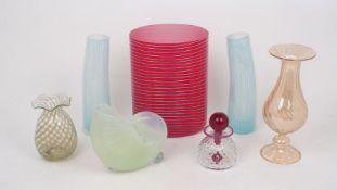 A Modern cased glass vase of oval section, in red over white and decorated with pale blue glass