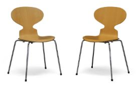 After Arne Jacobsen, a pair of beech 'Ant' chairs for Fritz Hansen c.1997, applied manufacturer's