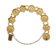A bracelet, composed of alternate circular and hexafoil links, each with raised Chinese good luck
