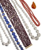 A collection of bead necklaces, including: a coral, corallium rubrum, double-row; a polished