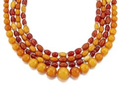 Four amber necklaces, comprising: a bead single row, graduating from approximately 18.7 to 8.0mm, to