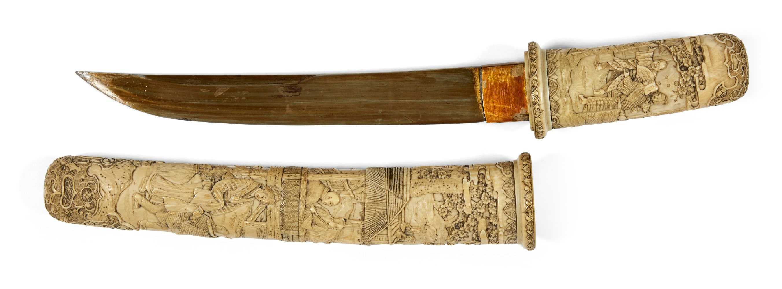 A Japanese carved ivory tanto, Meiji period, in slightly curved form, the scabbard and handle carved