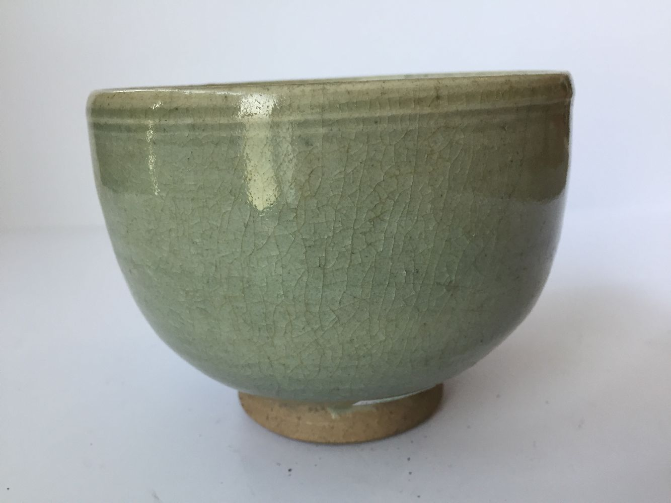 Three Thai Sawankhalok bowls, 15th-16th century, each covered in a celadon glaze, two with fluted - Image 12 of 27